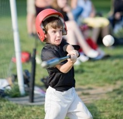Boy hitting ball